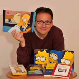 Erwin In het Panhuis mit Literatur und Filmen über die Simpsons.